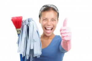 picture of Woman finished cleaning showing a happy thumbs up after a succesful spring cleaning. Beautiful mixed race asian / caucasian model isolated on white background. Shallow depth of field with focus on the thumb.