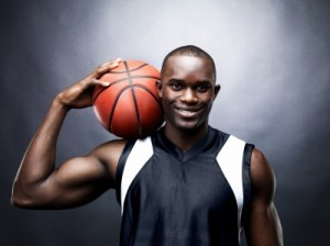 picture of  a happy male basketball player against dark background