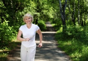 picture of older woman jogging in countryside