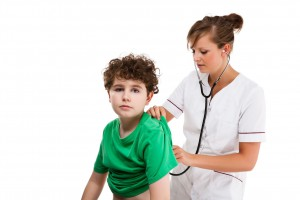 doctor doing check up on kid