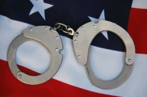 picture of american flag with handcuffs