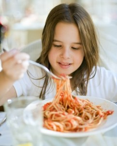 picture of girl eating pasta