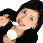 picture of woman eating yoghurt