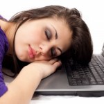 picture of woman sleeping on laptop