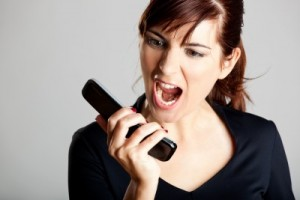 picture of mad woman screaming into telephone