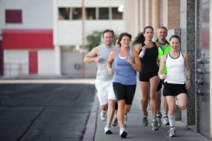 picture of men and woman jogging to stay fit