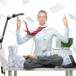 picture of woman sititng on desk yoga