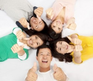 picture of group of asian young people lying together with thumb up