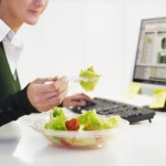 picture of woman eating salad