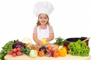 picture of little girl with fruits and vegetables