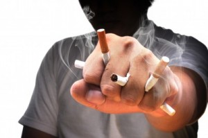 picture of A man fist full with cigarette with isolated white background