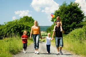 picture of Happy family walking down a path on a bright summer day