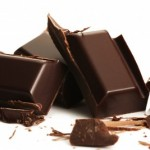 picture of broken plain chocolate pieces on white background