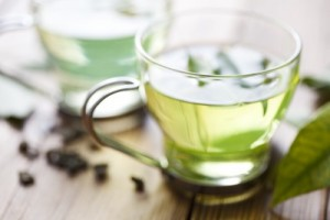 picture of close up of green tea or generic herbal tea, very shallow focus on the front of the cup