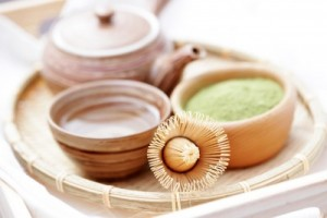 picture of green powder tea with bamboo whisk - tea time