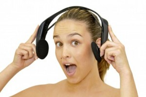 picture of happy young girl with headset listening to music isolated in white