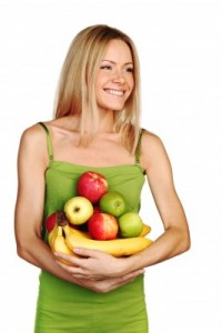 picture of woman holds a pile of fruit on a white background