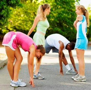 picture of group of people streaching out before workout