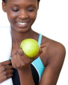 picture of Close-up of a fitness woman eating an apple