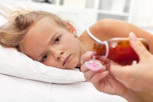 picture of Sick little girl with flu awaiting medication- focus on the eyes