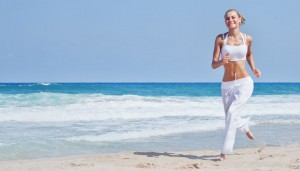 picture of Healthy woman running on the beach, girl doing sport outdoor, happy female exercising, freedom, vacation, fitness and heath care concept with copy space over natural background
