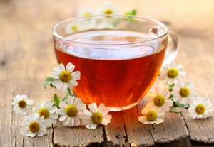 picture of chamomile tea and flowers