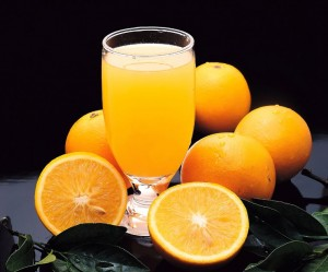 picture of oranges with glass of orange juice