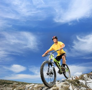 picture of A young man riding a mountain bike outdoor