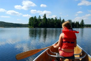 picture of kid in boat on lake