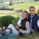 picture of Couple tasting wine in field