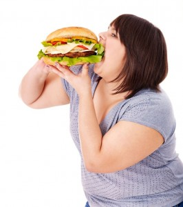 picture of woman eating burger