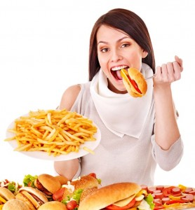 picture of woman eating fast food