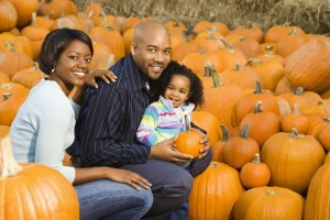 picture of family in pumpkin patch