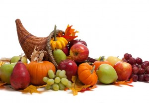 picture of A Fall arrangement in a cornucopia on a white background