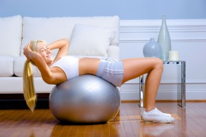 picture of woman working  out at home