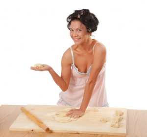 picture of woman making pizza