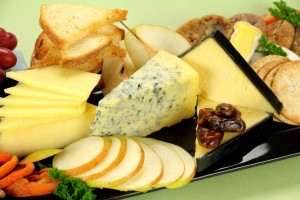 picture of Delicious cheese platter with various cheeses and fruits ready to serve