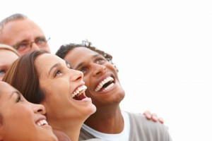 picture of happy men and woman looking up and laughing