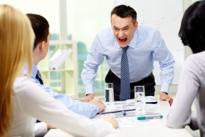 picture of Angry businessman shouting at his workers with an expressive look