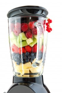 picture of Various healthy fresh fruit in the blender