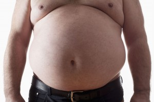 picture of big belly of a fat man isolated on white