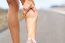 Cramps in leg calves or sprain calf on ttriathlete runner Sports injury concept with running man